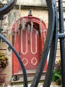 A glimpse through the fence at a historic Charleston home